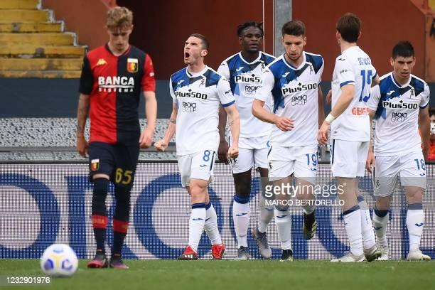 Atalanta's German defender Robin Gosens celebrates after scoring the third goal during the Italian Serie A football match Genoa vs Atalanta Bergamo...