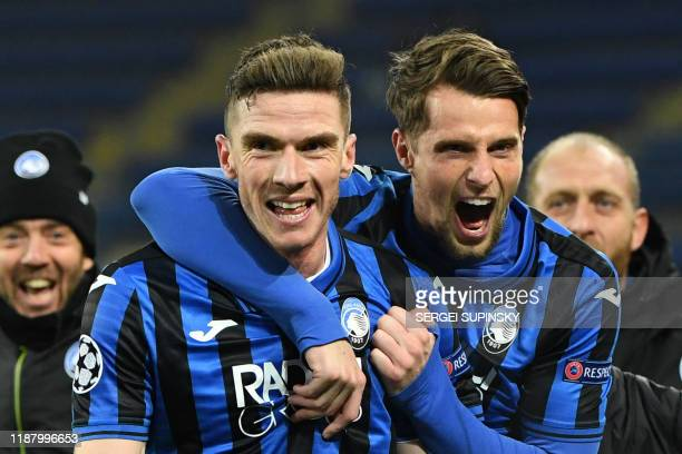Atalanta's German defender Robin Gosens celebrates with Atalanta's Dutch defender Hans Hateboer after scoring a goal during the UEFA Champions League...