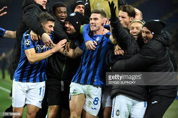 Atalanta's German defender Robin Gosens celebrates with teammates after scoring a goal during the UEFA Champions League group C football match...