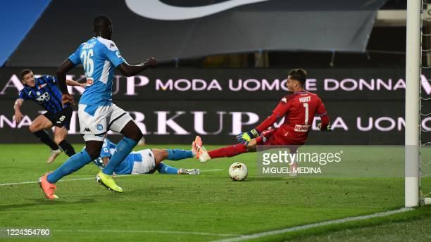 Atalanta's German defender Robin Gosens scores past Napoli's Italian goalkeeper Alex Meret during the Italian Serie A football match Atalanta vs...