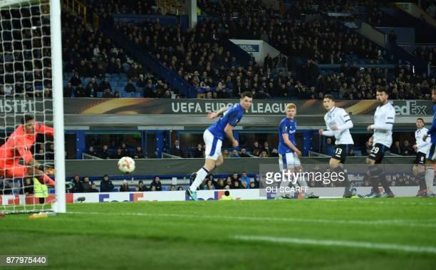 Atalanta's German midfielder Robin Gosens scores the team's third goal during the UEFA Europa League Group E football match between Everton and...
