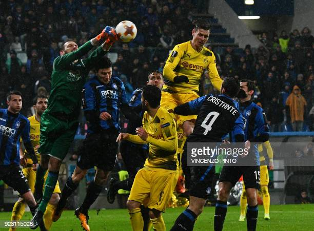 Atalanta's goalkeeper from Albania Etrit Berisha punches the ball over Borussia Dortmund's midfielder from Germany Marco Reus during the round of 32...