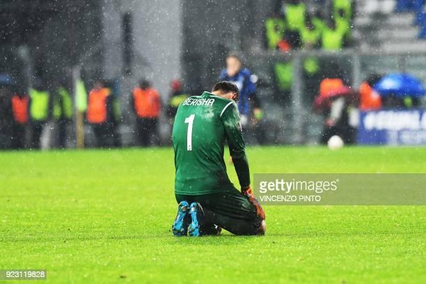 Atalanta's goalkeeper from Albania Etrit Berisha reacts at the end of the round of 32 second leg UEFA Europa League football match between Atalanta...