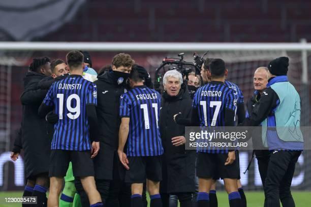 Atalanta's Italian coach Gian Piero Gasperini congratulates his players after winning the UEFA Champions League Group D football match between Ajax...
