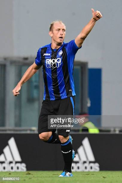 Atalanta's Italian defender Andrea Masiello celebrates after scoring a goal during the UEFA Europa League Group E football match between Atalanta and...