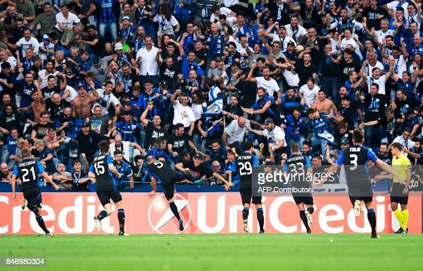 Atalanta's Italian defender Andrea Masiello celebrates with supporters after scoring a goal during the UEFA Europa League Group E football match...