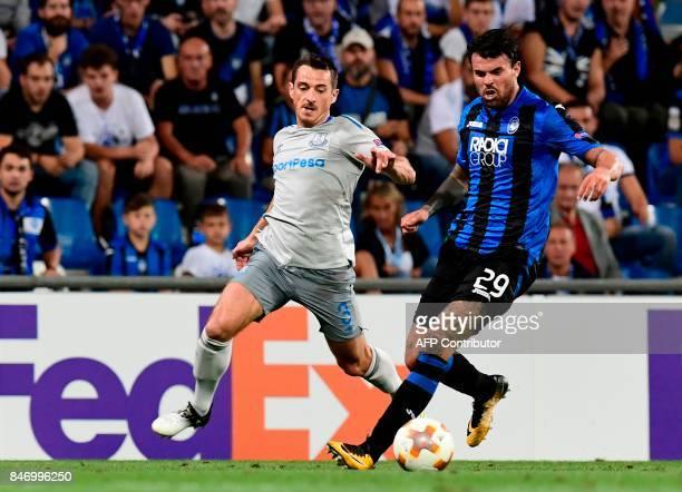 Atalanta's Italian forward Andrea Petagna vies with Everton's British defender Leighton Baines during the UEFA Europa League Group E football match...
