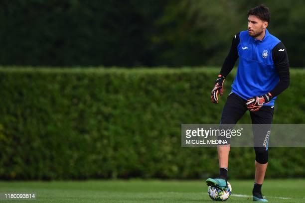 Atalanta's Italian goalkeeper Marco Sportiello attends a training session on the eve of the UEFA Champions League Group C football match Atalanta...