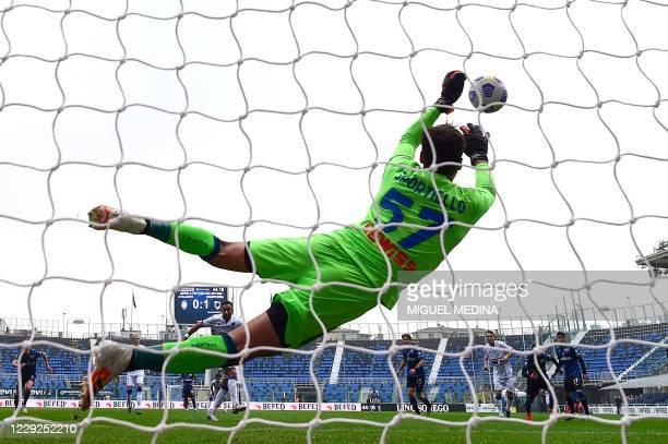 Atalanta's Italian goalkeeper Marco Sportiello stops a penalty kicked by Sampdoria's Italian forward Fabio Quagliarella during the Italian Serie A...