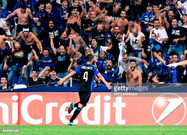 Atalanta's Italian midfielder Brian Cristante celebrates after scoring the third goal during the UEFA Europa League Group E football match between...