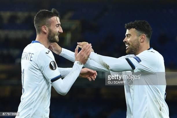 Atalanta's Italian midfielder Bryan Cristante celebrates with Atalanta's Italian striker Andrea Petagna scoring the team's second goal during the...