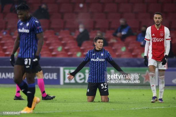 Atalanta's Italian midfielder Matteo Pessina reacts after being fouled during the UEFA Champions League Group D football match between Ajax Amsterdam...