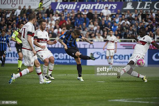 Atalanta's midfielder from Argentina Alejandro Gomez scores during the Italian Serie A football match Atalanta vs AC Milanon on April 3 2016 at the...