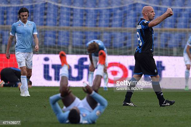 Atalanta's midfielder Giulio Migliaccio celebrates at the end of the Italian Serie A football match between Lazio Rome and Atalanta on March 9 2014...