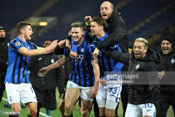 TOPSHOT Atalanta's players celebrate a goal during the UEFA Champions League group C football match between FC Shakhtar Donetsk and Atalanta BC at...