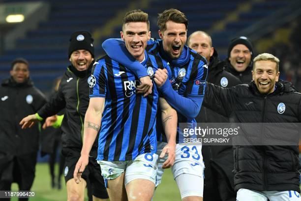 Atalanta's players celebrate a goal during the UEFA Champions League group C football match between FC Shakhtar Donetsk and Atalanta BC at the...