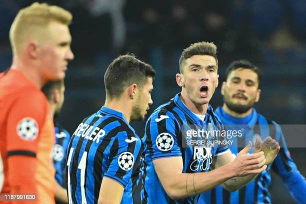 Atalanta's players celebrate a goal scored by Belgian defender Timothy Castagne and awarded after a VAR review during the UEFA Champions League group...