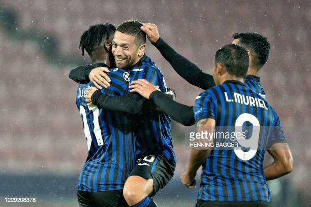 Atalanta's players celebrate after Atalanta's Argentine midfielder Alejandro Gomez scored a goal during the UEFA Champions League group D football...