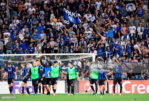 Atalanta's players celebrate after winning the UEFA Europa League match Atalanta vs Everton at the Mapei Stadium in Reggie Emilia on September 14,...