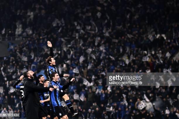 Atalanta's players celebrate at the end of the UEFA Europa League group E football match Atalanta vs Olympique Lyonnais at the Mapei Stadium in...