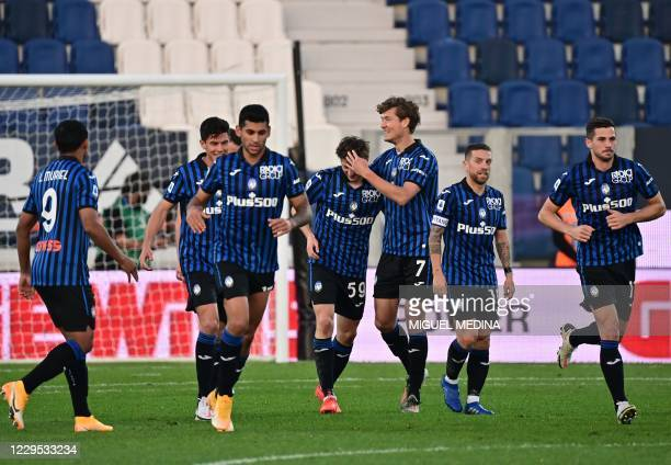 Atalanta's Russian midfielder Aleksey Miranchuk celebrates with teammates after scoring a goal during the Italian Serie A football match between...