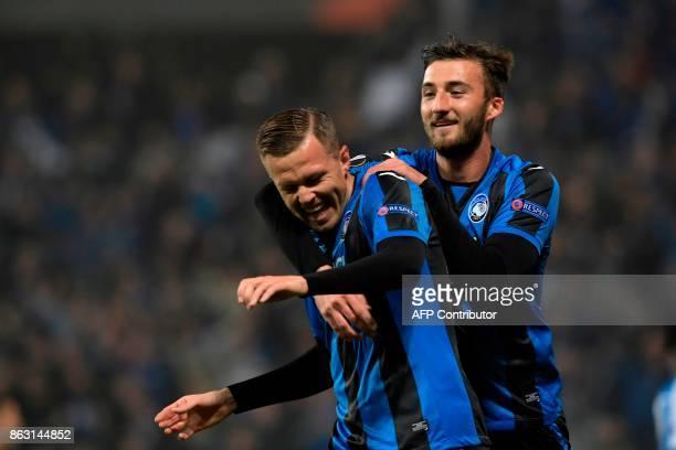 Atalanta's Slovenian forward Josip Ilicic celebrates with teammate Atalanta's Italian midfielder Brian Cristante after scoring during the UEFA Europa...