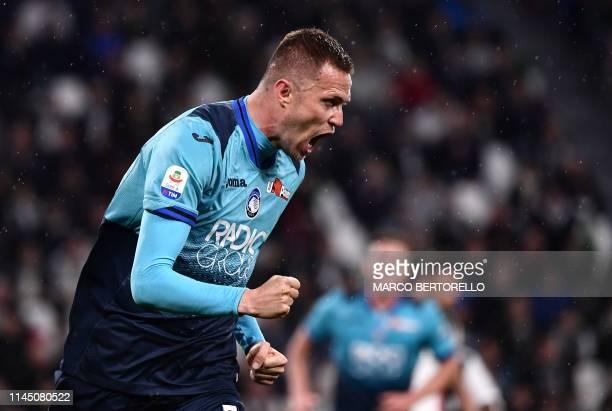 Atalanta's Slovenian midfielder Josip Ilicic celebrates after scoring during the Italian Serie A football match Juventus vs Atalanta on May 19 2019...
