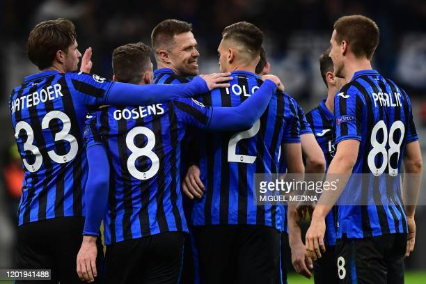 Atalanta's Slovenian midfielder Josip Ilicic celebrates after scoring during the UEFA Champions League round of 16 first leg football match Atalanta...