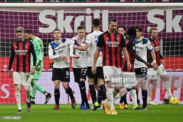 Atalanta's Slovenian midfielder Josip Ilicic celebrates after scoring a penalty during the Italian Serie A football match AC Milan vs Atalanta...