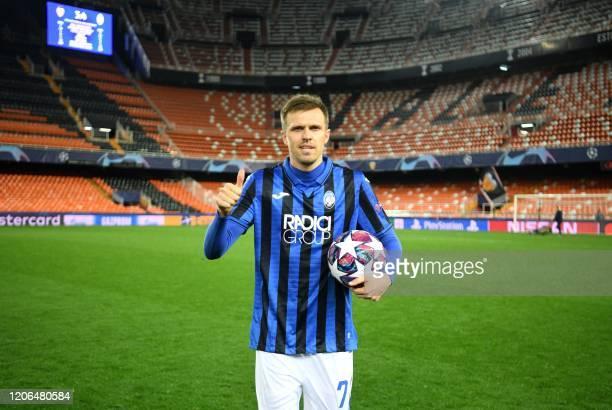 Atalanta's Slovenian midfielder Josip Ilicic celebrates after the UEFA Champions League round of 16 second leg match between Valencia CF and Atalanta...