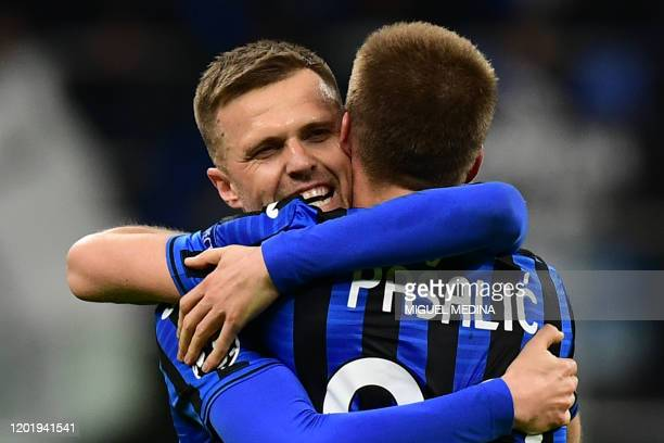 Atalanta's Slovenian midfielder Josip Ilicic celebrates with Atalanta's Croatian midfielder Mario Pasalic after scoring during the UEFA Champions...