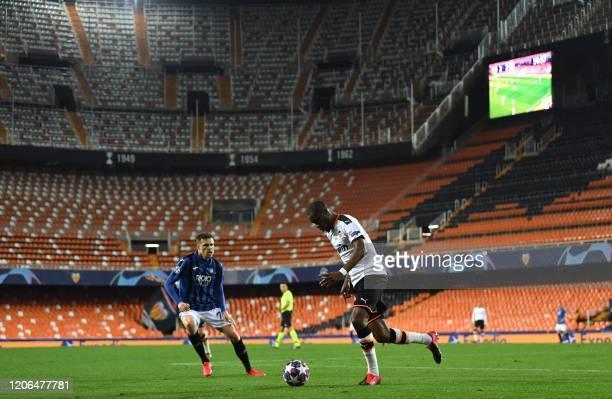 TOPSHOT Atalanta's Slovenian midfielder Josip Ilicic challenges Valencia's Central African RepublicFrench midfielder Geoffrey Kondogbia during the...