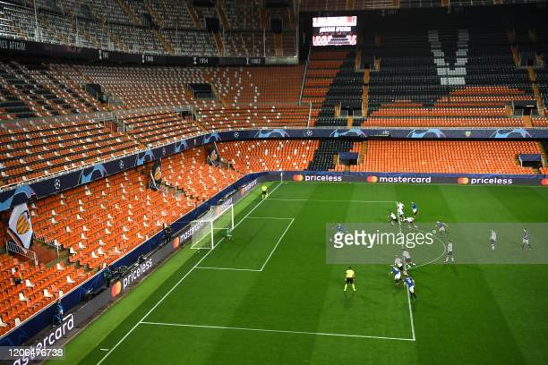 TOPSHOT Atalanta's Slovenian midfielder Josip Ilicic scores during the UEFA Champions League round of 16 second leg match between Valencia CF and...