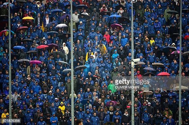 TOPSHOT Atalanta's supporters follow the game under rain during the Italian Serie A football match Atalanta vs AS Roma on April 17 2016 at the Azzuri...