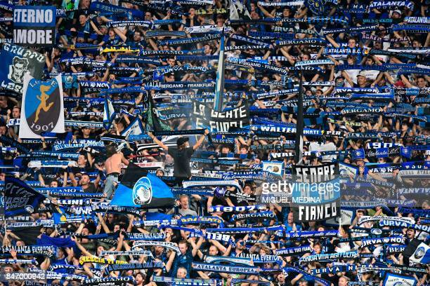 Atalanta's supporters hold scarves during the UEFA Europa League Group E football match between Atalanta and Everton at the Mapei Stadium in Reggio...