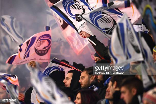 Atalanta's supporters wave flags during the UEFA Europa League group E football match Atalanta vs Olympique Lyonnais at The Mapei Stadium in Reggio...