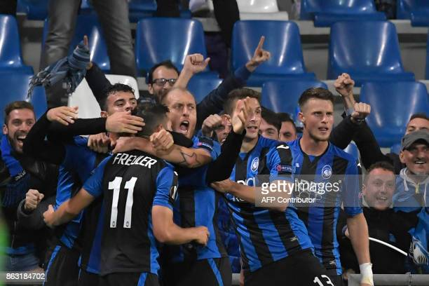 Atalanta's Swiss midfielder Remo Freuler celebrates after scoring the third goal during the UEFA Europa League group E football match Atalanta vs...