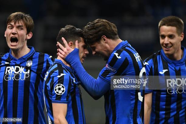 Atalanta's Swiss midfielder Remo Freuler celebrates with Atalanta's Dutch defender Hans Hateboer after scoring during the UEFA Champions League round...