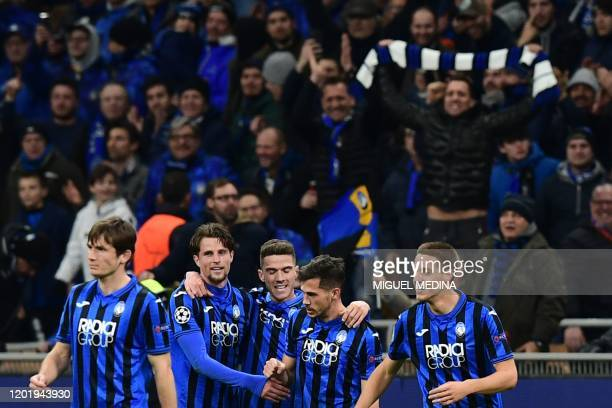 Atalanta's Swiss midfielder Remo Freuler celebrates with teammates Atalanta's Dutch defender Hans Hateboer after scoring during the UEFA Champions...