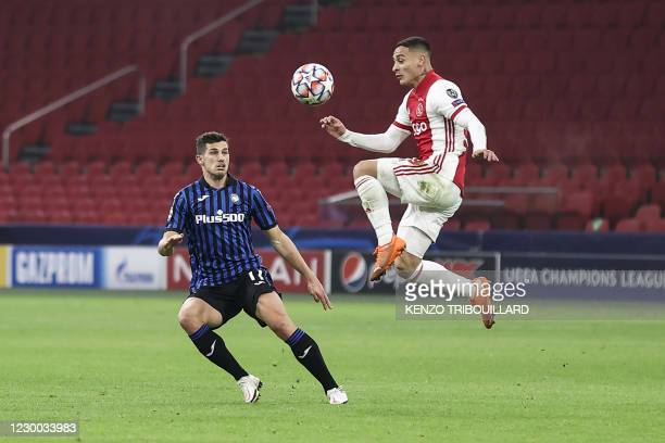 Atalanta's Swiss midfielder Remo Freuler fights for the ball with Ajax's Brazilian forward Antony Matheus Dos Santos during the UEFA Champions League...