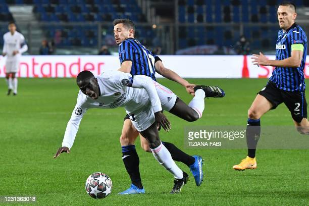 Atalanta's Swiss midfielder Remo Freuler tackles Real Madrid's French defender Ferland Mendy during the UEFA Champions League round of 16 first leg...