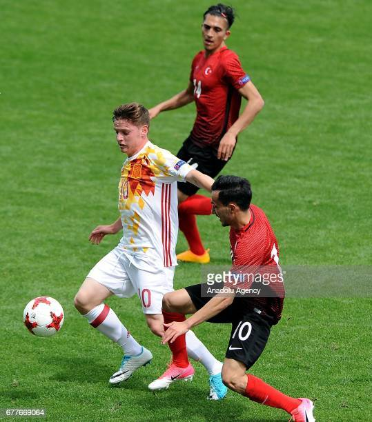 Atalay Babacan of Turkey in action againstSergio Gomez of Spain during the Uefa U17 Championship Group A first round match between Turkey and Spain...