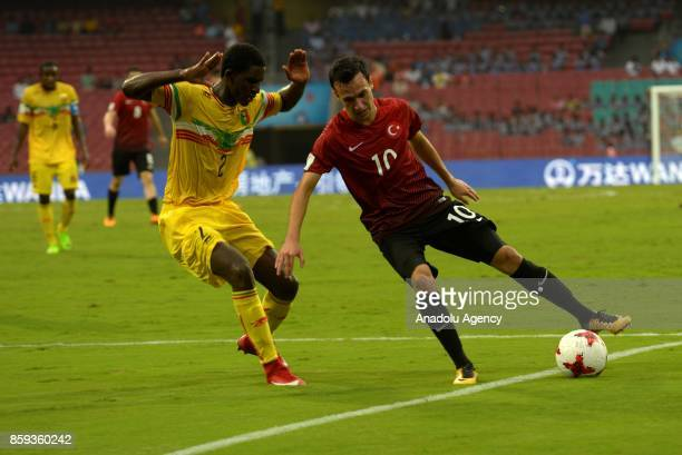 Atalay Babacan of Turkey is in action against Boubacar Haidara of Mali during the ceremony within a 2017 FIFA U-17 World Cup football match between...