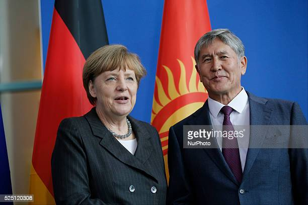 Atambajew of Kyrgyzstan and the German Chancellor Angela Merkel give a joint press conference after meeting at the German Chancellery on February 03...