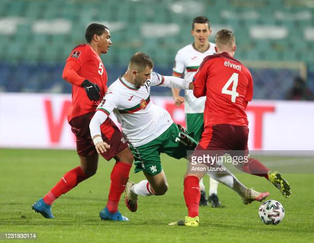 Atanas Iliev of Bulgaria is challenged by Manuel Akanji and Nico Elvedi of Switzerland during the FIFA World Cup 2022 Qatar qualifying match between...