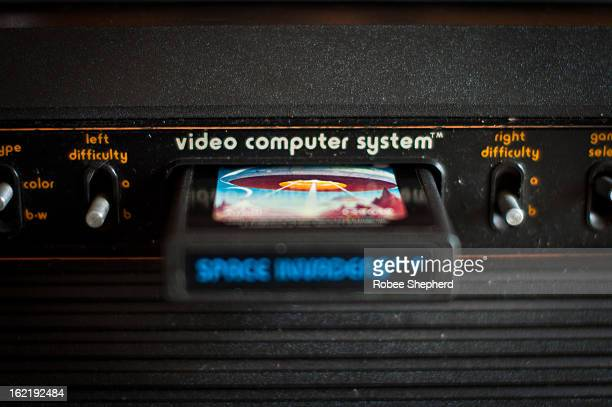 CONTENT] Atari 2600 VCS console close up of inserted cartridge and central switches Space Invaders game is inserted Difficulty switches visible...