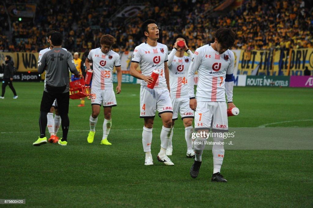 Ataru Esaka (R) and Omiya Ardija players show dejection after their 0-3 defeat in the J.League J1 match between Vegalta Sendai and Omiya Ardija at Yurtec Stadium Sendai on November 18, 2017 in Sendai, Miyagi, Japan.
