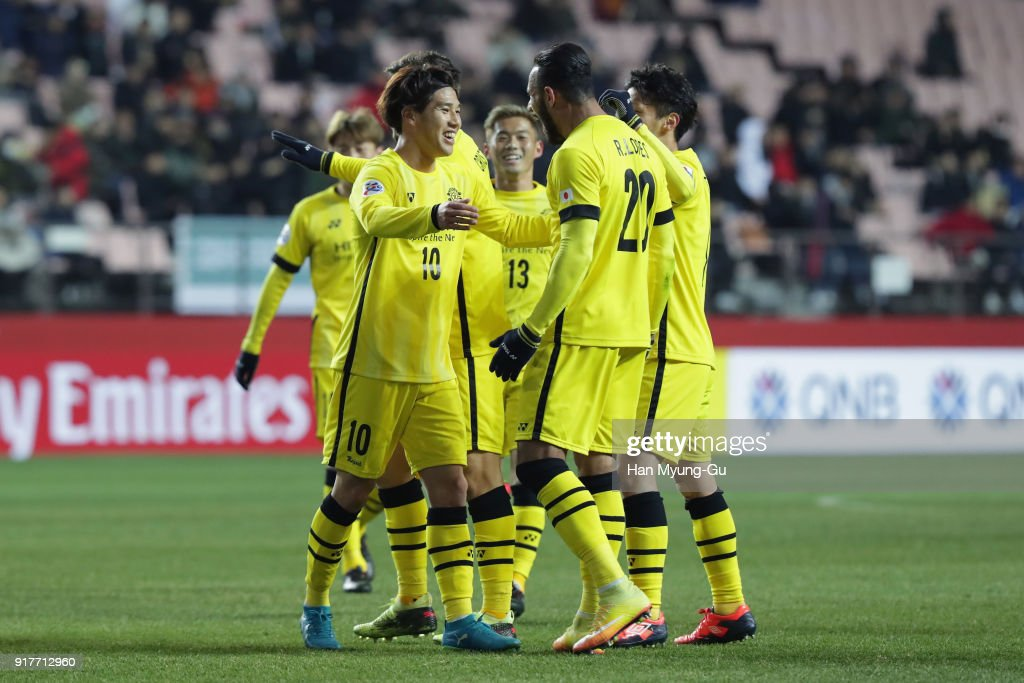 Ataru Esaka (L) of Kashiwa Reysol celebrates scoring his side's second goal with his team mates during the AFC Champions League Group E match between Jeonbuk Hyundai Motors and Kashiwa Reysol at the Jeonju World Cup Stadium on February 13, 2018 in Jeonju, South Korea.