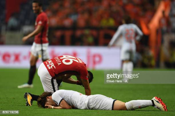 Ataru Esaka of Omiya Ardija and Ryota Moriwaki of Urawa Red Diamonds react after their collision during the JLeague J1 match between Urawa Red...