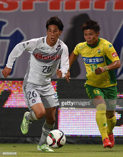 Ataru Esaka of Thespa and Takashi Kanai of JEF United compete for the ball during the JLeague second division match between JEF United Chiba and...